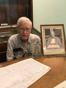 Mr. Fly with museum exhibit featuring his father